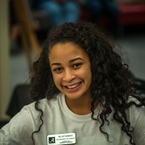 A female student smiles into the camera.