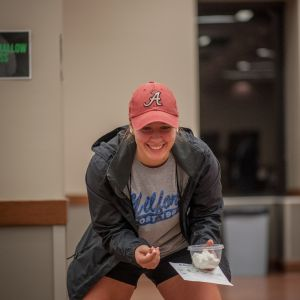 A female student laughs as she catches a marshmallow during the Live Action Game Night.