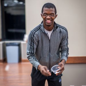 A male student laughs as he tosses marshmallows during the Live Action Game Night.