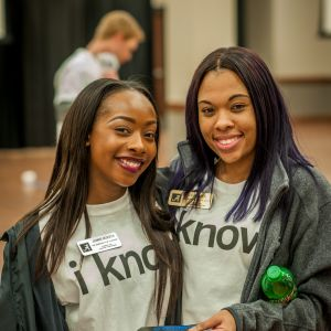 Two female students pose together and smile for the camera during the Live Action Game Night.
