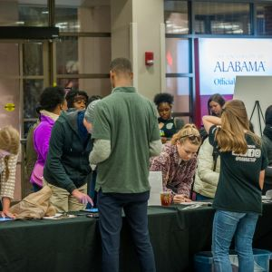 Students check in for an event at a check-in table at the Ferguson Center.