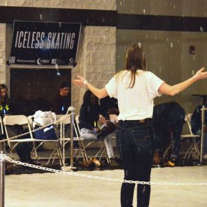 A female student participates in iceless skating at the Winter Welcome Bash.