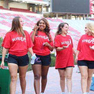 "Pictured is four female students walking into Bryant Denny Stadium all wearing shirts that read ""Script A"""